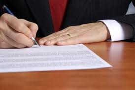 lawyer signing paper Reno Corporate Services lawyer