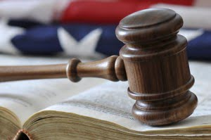 Asset Protection Attorney book and gavel and flag
